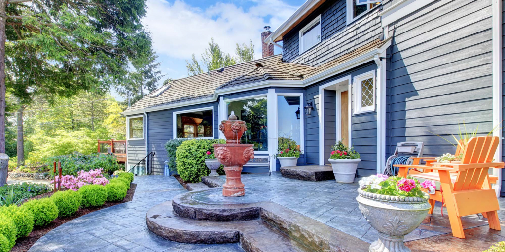 A lovely front porch and garden with a water feature