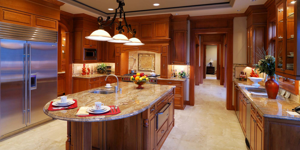 A rich kitchen with wooden cabinets and marble countertops