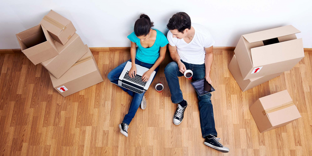 A man and woman enjoy coffee while unpacking